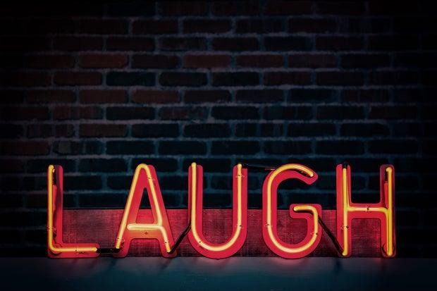 Laugh neon sign