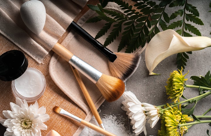 Makeup brushes and flowers