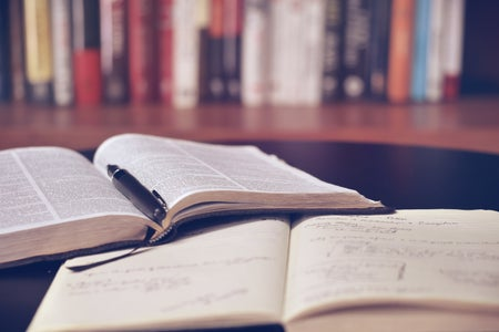 Two open books in a library