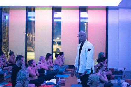 Cidney teaching yoga  students