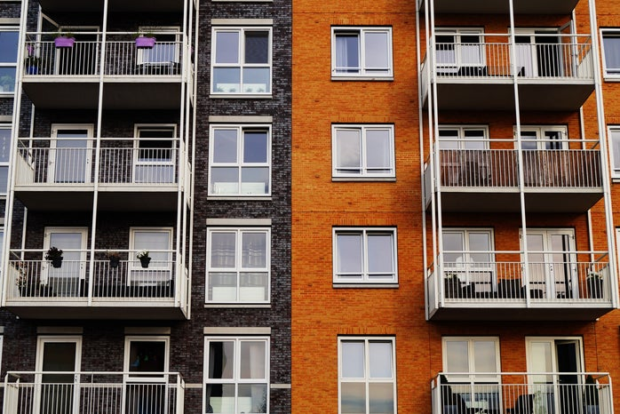 Exterior of apartment with left side black and right side orange