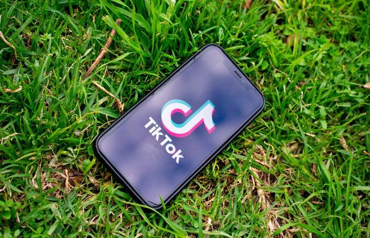 phone with tiktok logo on the grass