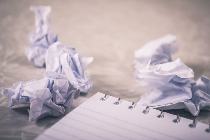 notebook and crumpled paper