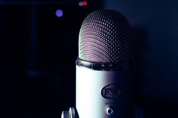 Gray Blue Yeti microphone in dark room