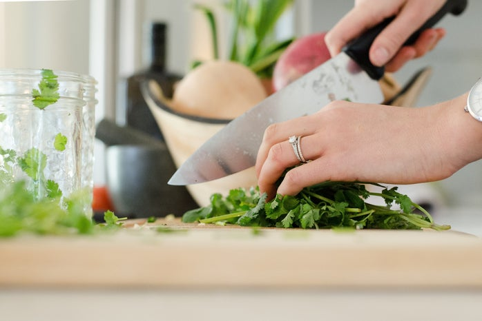 woman\'s hands cutting vegetables