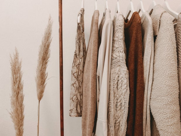 brown and tan clothes hanging on a rack