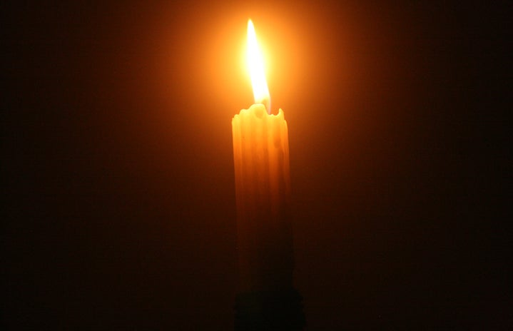 An image of a candle in the dark
