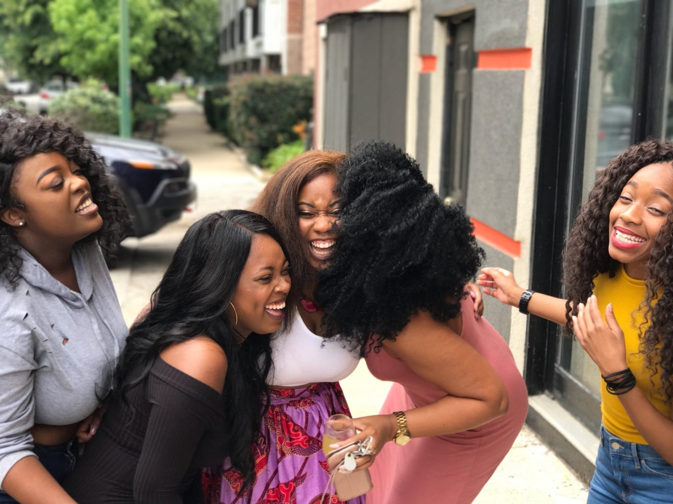 five women laughing together