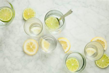 lemon water in glasses on marble countertop