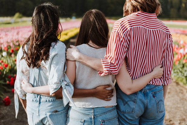 friends with arms around each other