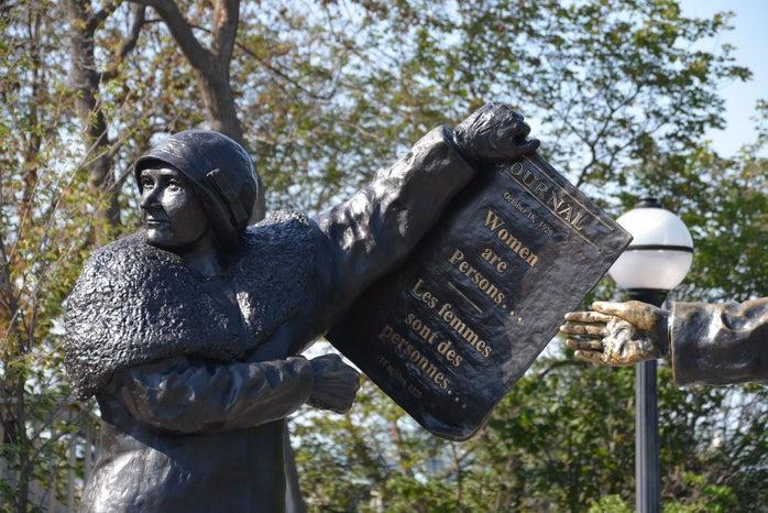 """Henrietta Muir Edwards holding paper \""""Women are persons/Les femmes sont des personnes\"""""""