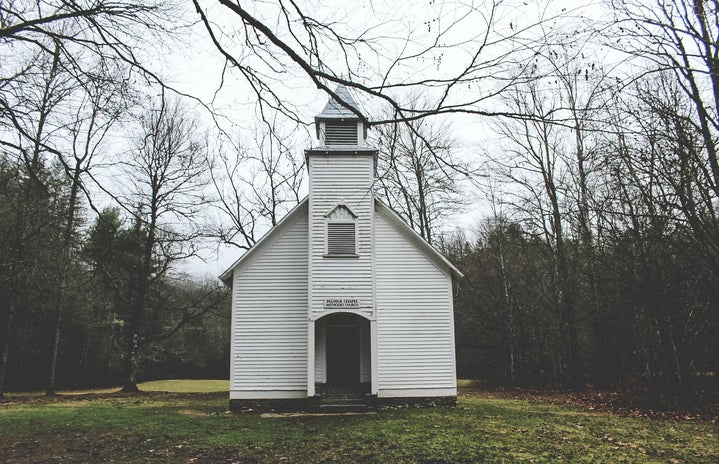 Small white chapel in woods