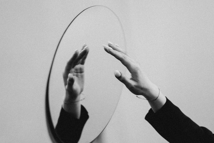 A hand reflected in the mirror