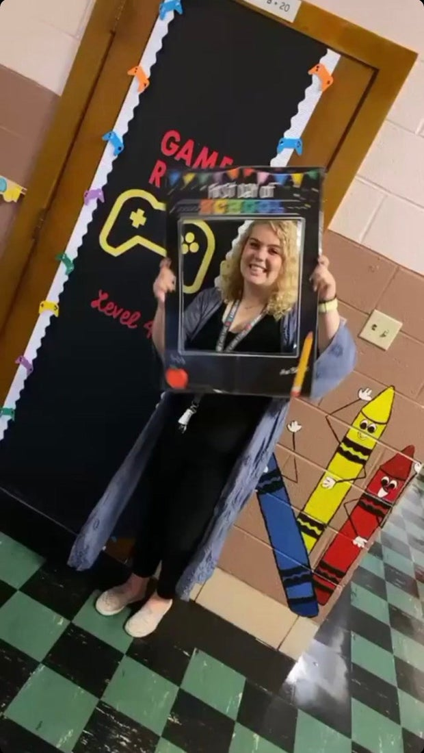 Teacher standing with Classroom Decorations